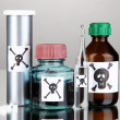 Stock Photo: Deadly poison in bottles on grey background