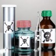 Deadly poison in bottles on grey background - Stok fotoğraf