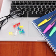 Royalty-Free Stock Photo: Laptop with stationery on table