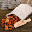 Beans in sack on wooden background - ストック写真