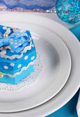 Blue gift for guests on wedding table close-up — Stock Photo