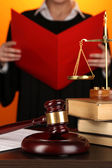 Judge read verdict on orange background — Stock Photo