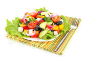 Tasty Greek salad isolated on white — Stock Photo