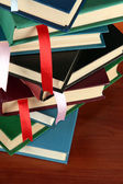 Many books with bookmarks on brown background — Stock Photo