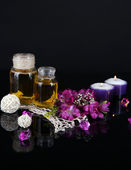 Spa oil and freesia isolated on black — Stok fotoğraf