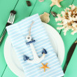 Marine table setting on color wooden background — Stock Photo