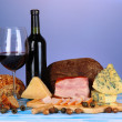 Exquisite still life of wine, cheese and meat products — Stock Photo #23604145