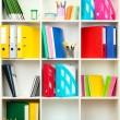 White office shelves with different stationery, close up — Stock Photo #23604647