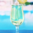 Green cocktail with lime on table on bright background — Stockfoto