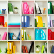 White office shelves with different stationery, close up — Stock Photo #23605187