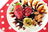 Fruit in chocolate on a red napkin polka dot — 图库照片