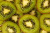 Kiwi segmenten achtergrond — Stockfoto