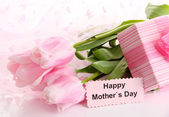 Bouquet of pink tulips and gift for Mother's Day — Stock Photo