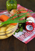 Composition of vegetables on wooden background — Stock Photo