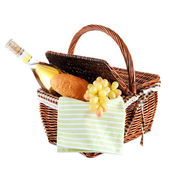 Picnic basket with grape and bottle of wine, isolated on white — Stock fotografie
