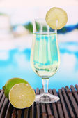 Green cocktail with lime on table on bright background — Foto de Stock
