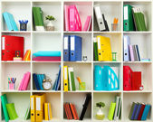White office shelves with different stationery, close up — Foto Stock