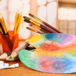 Royalty-Free Stock Photo: Artistic equipment: paint, brushes and art palette