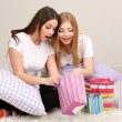 Royalty-Free Stock Photo: Two girl friends out gifts on room