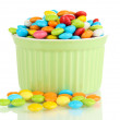 Colorful candies in bowl isolated on white - Foto Stock