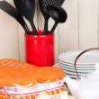 Kitchen settings: utensil, potholders, towels and else  on wooden table - Foto Stock