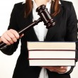 Woman holding wooden gavel and law books isolated on white — Stock Photo #23655727