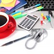 Royalty-Free Stock Photo: Laptop with stationery and cup of coffee isolated on white