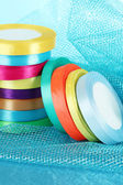 Bright ribbons on blue background — Stock Photo