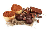 Composition of chocolate sweets and cocoa, isolated on white — Stock Photo