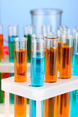 Test-tubes on color background — Stock Photo