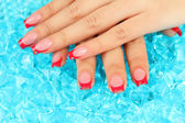 Closeup of hands of young woman with elegance manicure on bright background — Stock Photo