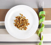 Wheat germs on plate and measuring tape, close up — Stock Photo