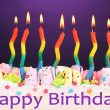Birthday cake with candles on violet background — Stok fotoğraf