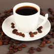Cup of strong coffee on grey background — Stockfoto