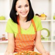 Girl housewife with delicious pizza on kitchen background — Foto de Stock