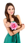 Young beautiful girl in green dress and decorative flower on her hand, isolated on white — Stock Photo