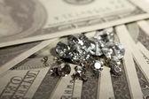 Beautiful shining crystals (diamonds) on money background — Stockfoto
