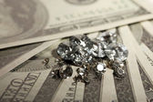 Beautiful shining crystals (diamonds) on money background — Foto de Stock