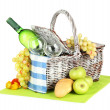 Picnic basket with fruits and bottle of wine, isolated on white - Photo