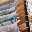 Men&#039;s shirts on hangers on beige background - Stock Photo
