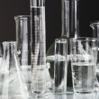 Test tubes on gray background — 图库照片