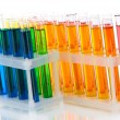 Stock Photo: Colorful test tubes isolated on white