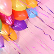 Many bright balloons under ceiling close-up — Stock Photo #23889675