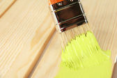 Brush painting wooden furniture, close up — Stock Photo