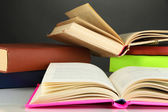 Stack of books on gray background — Stock Photo