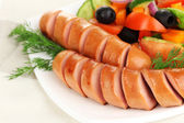 Grilled sausage with fresh salad close up — Stock Photo