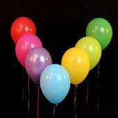 Balloons rainbow colors isolated on black — Stock Photo