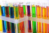 Colorful test tubes isolated on white — Foto de Stock