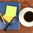 Stock Photo: Cup of coffee on worktable close up