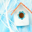 Decorative nesting box on color background - Stock Photo